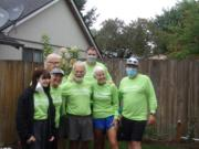 Participants in the G&L (Greenwood and Lindell) Family triathlon and run/walk pose with their T-shirts. Front row from left, Cleo Greenwood, Susan Ford, Mike Greenwood, Kathy Murphy and Kevin Greenwood. Back row, Bob Ford and Rian Lindell.