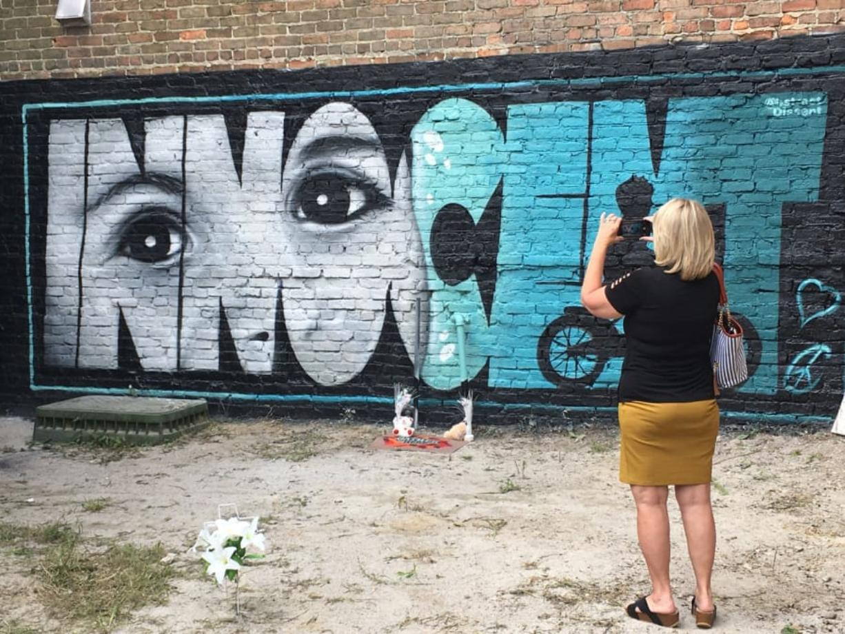 Ruth Godwin visits a mural painted in memory of Cannon Hinnant, a 5-year-old boy from Wilson, N.C., who was shot and killed in his front yard.