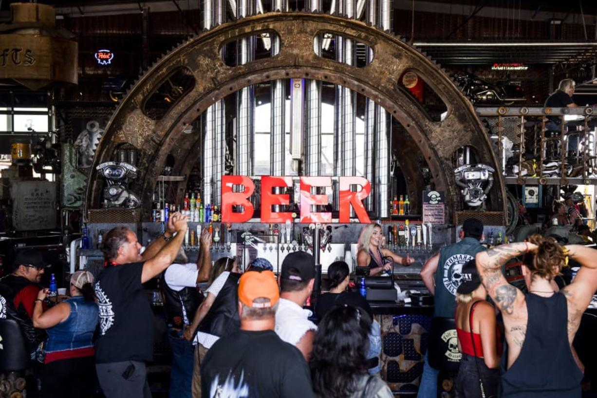 People watch a concert at the Full Throttle Saloon during the 80th Annual Sturgis Motorcycle Rally in Sturgis, South Dakota on AUg. 9, 2020.