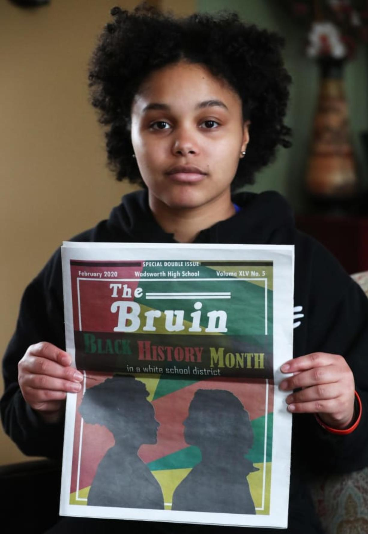Aniya Harris a senior at Wadsworth High holds a copy of the Wadsworth Bruin, the school's newspaper, with the cover story on Black History Month in a White School District at her Wadsworth home on Tuesday, Feb. 25, 2020. Harris, who is on the cover as the silhouette on the left, also wrote a column that accompanies the main story.  The district pulled the pulled the issue and reprinted it without the words in a white school district.