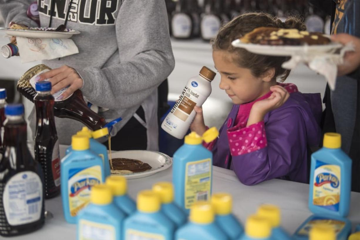 The Columbian files   Makayla Killam, 5, watches as syrup is poured onto her pancakes at the 2019 Clark County Fair.
