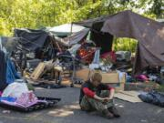 Aaron Anthony Christopher spends a quiet moment at his homeless encampment in northeast Vancouver in July.