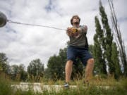 Trey Knight runs through a hammer throwing session at his home in Ridgefield on July 23, 2020. Knight is headed to USC in Los Angeles, Ca., next month to continue his track career.