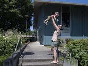 Van Lattin of Vancouver, who was born last August, gets a lift from his mom, Cindy Lowry, while enjoying some playtime near the Marshall Center in Vancouver.