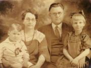 Charles Cecil Curtis, pastor of the First Christian Church, pictured here with his family, was also the Ku Klux Klan's provisional Grand Dragon of Washington State in the early 1920s.