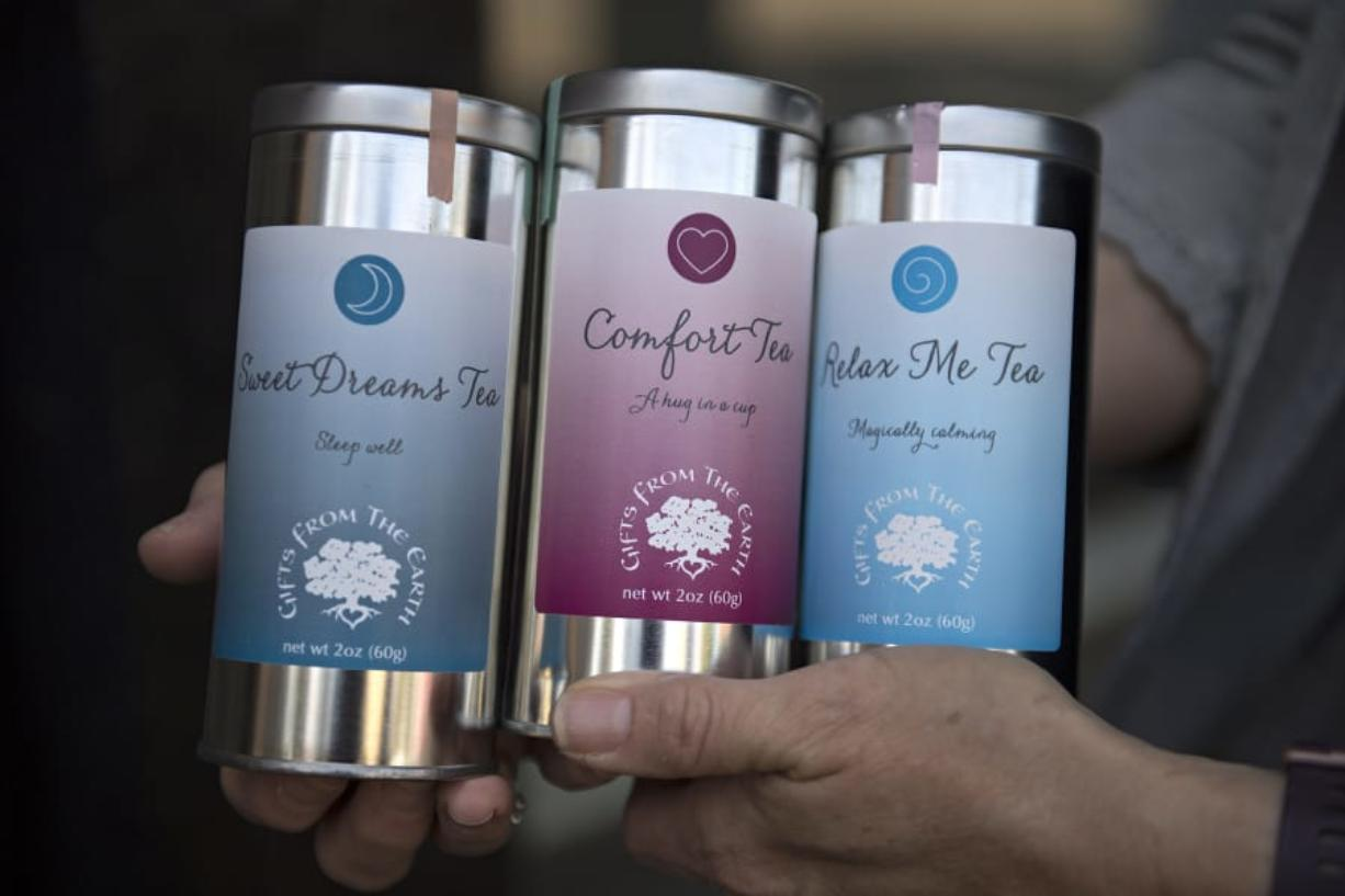 """Marianne Wilson Stein displays """"Gifts From the Earth"""" teas, which will be available at her future downtown storefront, The Dandelion Teahouse Apothecary at 109 W. Seventh St."""