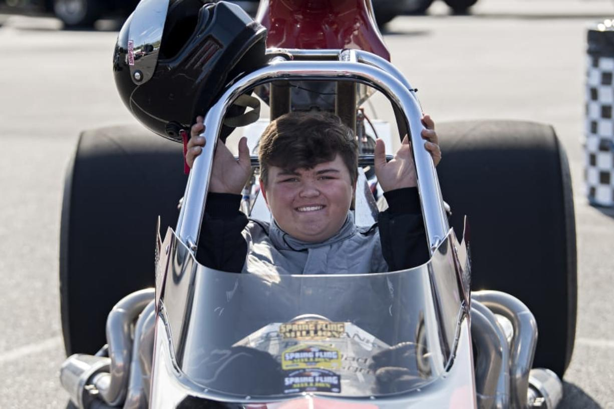 Cooper Chun, 16, of Vancouver pauses for a photo in his 1999 Mullis Rear Engine Dragster at Portland International Raceway on Wednesday evening, August 12, 2020.