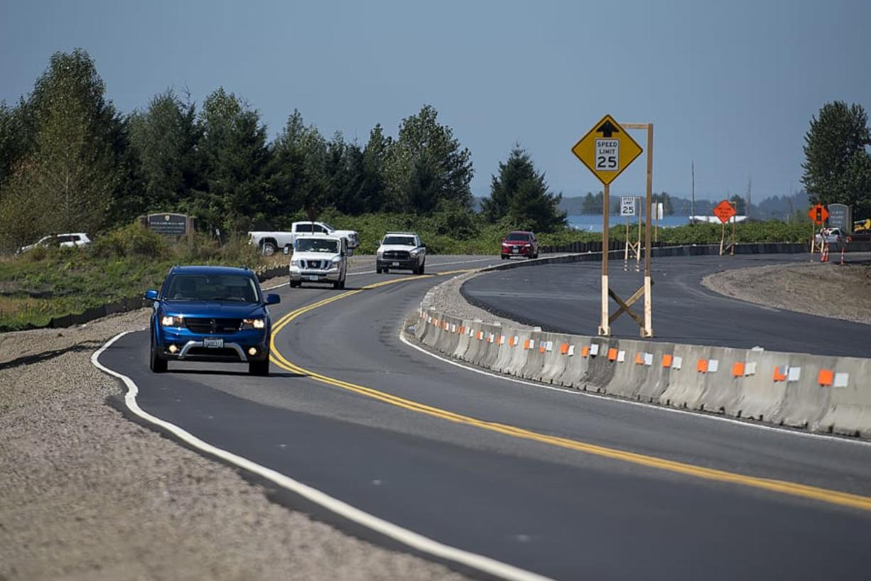 Motorists traveling east on state Highway 14 in Washougal pass an elevated section of the road as construction crews work near Steigerwald Lake National Wildlife Refuge. The highway is being raised above the 500-year flood level in preparation for the removal of a section of levee to restore the Steigerwald area's connection to the Columbia River.