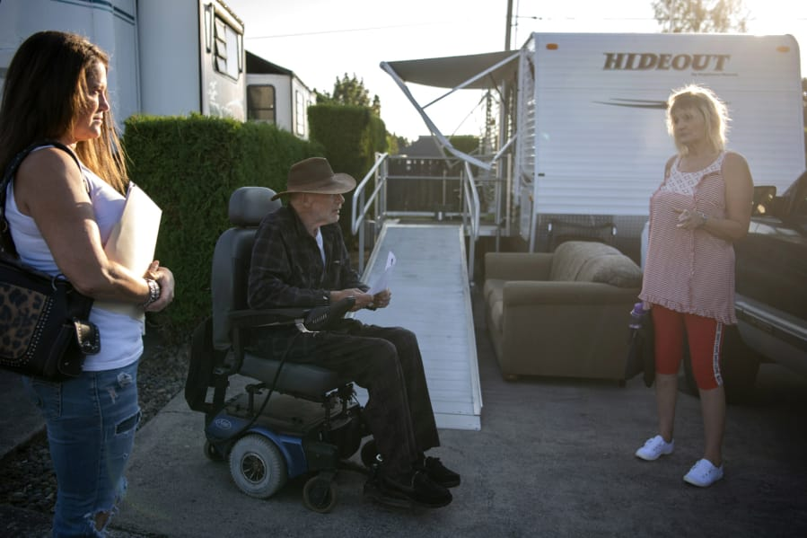 Michele Houston, from left, chats with Bill Wickens and Cindy Genschorck at Hazel Dell RV Park. Wickens has lived at the park for 13 years and said that with the rent increase, 75 percent of his monthly income will go to rent.