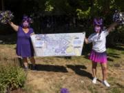 Christyna Hengstler, left, and her friend and co-worker Amanda McCallum pose at Hengstler's home in Vancouver. With the support of their work, 1st Choice Advisory, the friends are walking together in the Walk to End Alzheimer's on Aug. 29. Hengstler's grandmother has Alzheimer's, and McCallum's mother passed away from Alzheimer's.