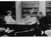 Future poet Elizabeth Crawford Yates and her father, W.E. Yates, share a partner's desk in his law office at 413-415 Main St., Vancouver, in this undated photo. Her father, a prominent attorney, prosecuted an Industrial Workers of the World member for sedition in 1921, possibly around the time of this photo.