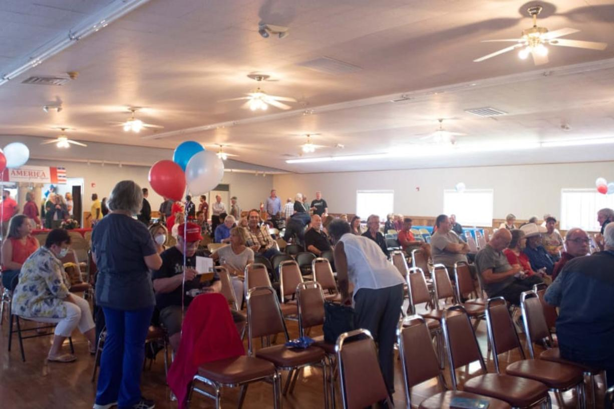 Attendees gather at a meet-and-greet event for Republican candidates at the former Clark County Square Dance Center in Brush Prairie Tuesday, Aug. 25. Around 100 people attended.
