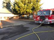 Vancouver firefighters quickly extinguished an attic fire at a house in the Five Corners area Friday evening.