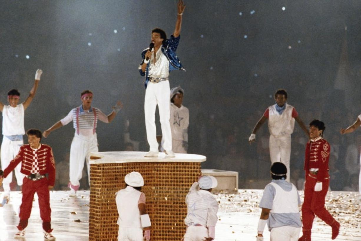 Singer Lionel Ritchie performs Aug. 12, 1984, during the closing ceremony of the Summer Olympic Games in Los Angeles.
