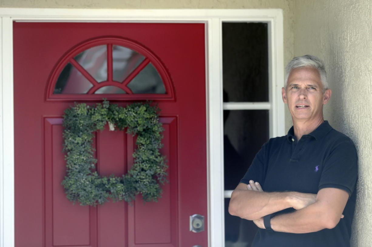 Bob Garick stands by the entrance to his home Wednesday, Aug. 5, 2020, in Oviedo, Fla. Garick was looking forward to being a field supervisor during the door-knocking phase of the 2020 census, but as the number of new coronavirus cases in Florida shot up last month, he changed his mind and decided not to take the job.