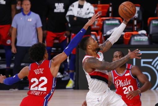 Portland Trail Blazers' Damian Lillard shoots next to Philadelphia 76ers' Matisse Thybulle, left, during the fourth quarter of an NBA basketball game Sunday, Aug. 9, 2020, in Lake Buena Vista, Fla. (Kevin C.