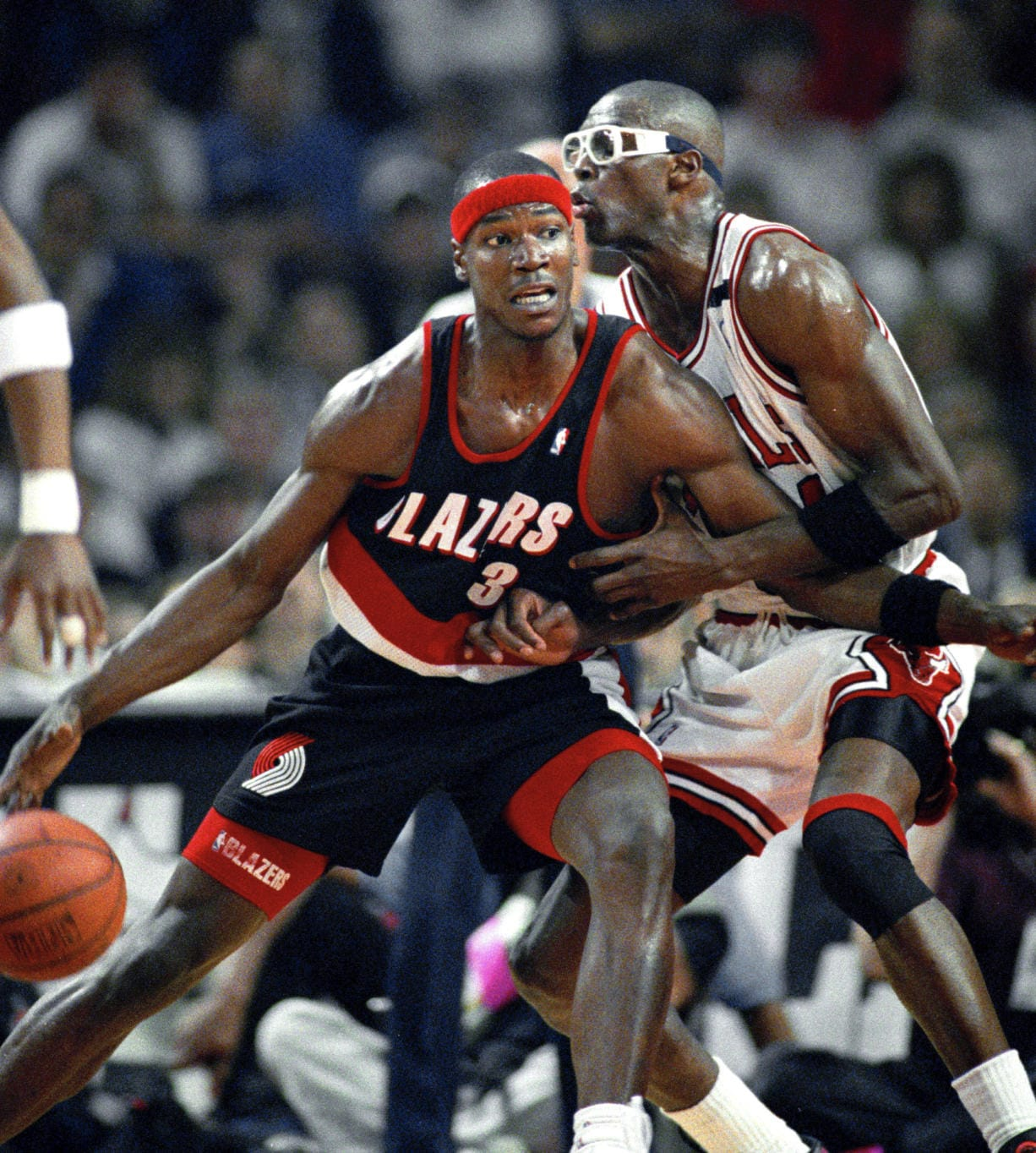 Portland Trail Blazers' Cliff Robinson drives on Chicago Bulls' Horace Grant during Game 1 of the 1992 NBA Finals in Chicago. Robinson, an early star on UConn's rise to power and longtime top sixth man in the NBA, has died. He was 53. Robinson's death was confirmed by UConn, Saturday, Aug. 29, 2020.