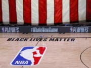 An empty court and bench are shown following the scheduled start time of Game 5 of an NBA basketball first-round playoff series, Wednesday, Aug. 26, 2020, in Lake Buena Vista, Fla. All NBA playoff games scheduled for Wednesday and Thursday were postponed, with players around the league choosing to boycott in their strongest statement yet against racial injustice. (Kevin C.