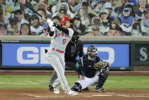 Los Angeles Angels' Shohei Ohtani (17) watches his solo home run as Seattle Mariners catcher Joe Hudson, right, looks on during the second inning of a baseball game Thursday, Aug. 6, 2020, in Seattle. (AP Photo/Ted S.