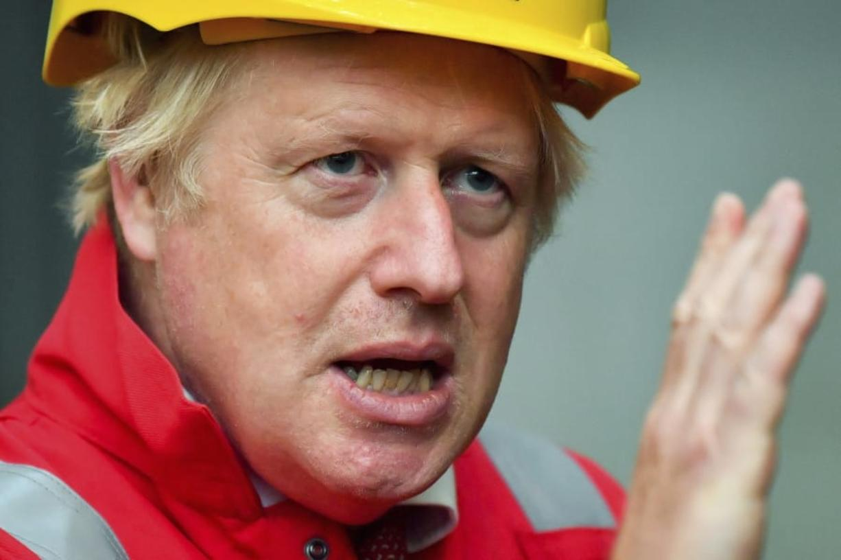 Britain's Prime Minister Boris Johnson gestures, during his visit to Appledore Shipyard in Devon, England, Tuesday, Aug. 25, 2020.