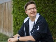 Casey Ellson, 16, is pictured at his home in Vancouver on July 31, 2020. Ellson came out to his mom as gender fluid and non-binary in 6th grade, and shortly after he said he came out as transgender, identifying as he/him. Ellson grew up in Girl Scouts, and after he came out as transgender and began his transition he knew he still wanted to remain a Girl Scout.