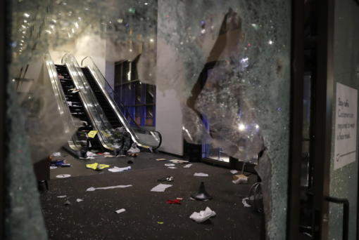 Glass is shattered in the Nordstrom store after a riot occurred in the Gold Coast area of the city early in the morning of Monday, Aug. 10, 2020 in Chicago.  Hundreds of people smashed windows, stole from stores and clashed with police in Chicago's Magnificent Mile shopping district and other parts of the city's downtown. (Jose M.