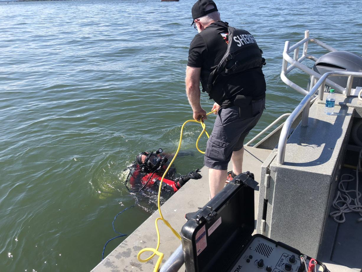A dive team from the Multnomah County Sheriff's Office searches the Columbia River off Marine Drive for a man presumed drowned on Sunday, Aug. 2. The man, who was not wearing a life jacket, was ejected from a speeding boat that flipped just before 2 p.m. on Sunday.
