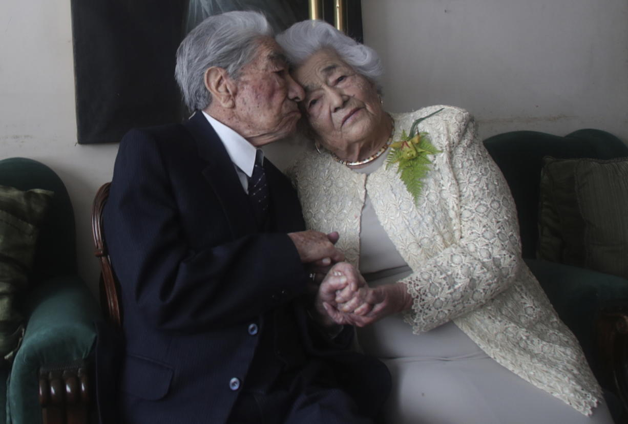 Married couple Julio Mora, 110, and Waldramina Quinteros, 104, both retired teachers, pose for a photo Friday at their home in Quito, Ecuador. The couple is recognized by the Guinness World Records as the oldest married couple in the world, because of their combined ages. They have been married for 79 years.