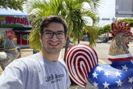 In this photo provided by Robert Lewis, Lewis takes a selfie in the Little Havana neighborhood in Miami, Wednesday, Aug. 5, 2020. Until recently, Lewis had never heard of Karen Bass, the California congresswoman in contention to be Democratic presidential candidate Joe Biden's running mate. But the recent college graduate had long heard stories from his grandfather recounting the days of oppression in Cuba under Fidel Castro.