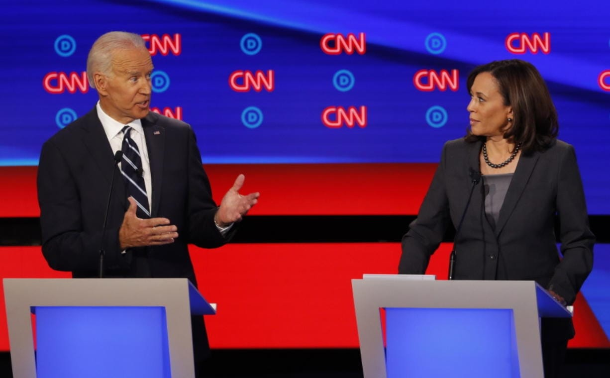 FILE - In this July 31, 2019, file photo, then-Democratic presidential candidate Sen. Kamala Harris, D-Calif., listens as Democratic presidential candidate former Vice President Joe Biden speaks during a Democratic presidential primary debate at the Fox Theatre in Detroit. Democratic presidential candidate former Vice President Joe Biden has chosen Harris as his running mate.