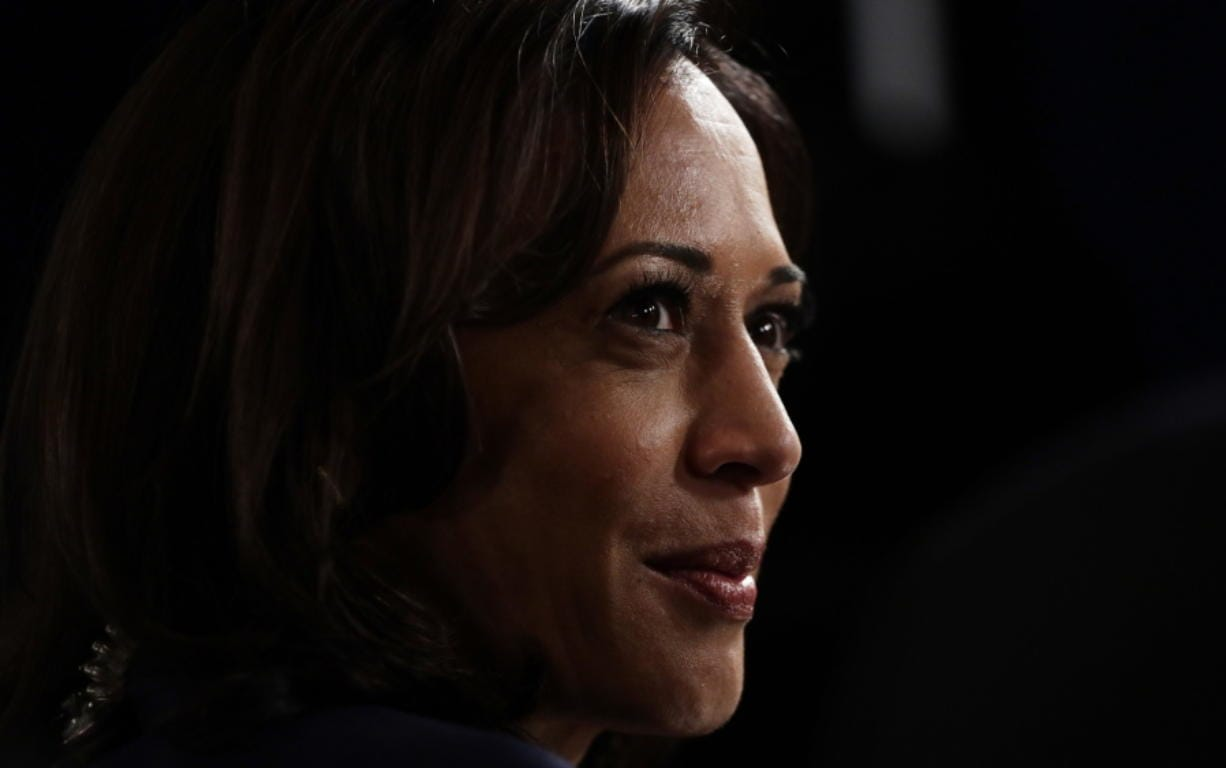 FILE - In this Sept. 12, 2019, file photo Sen. Kamala Harris, D-Calif., talks to the media in the spin room following the Democratic presidential primary debate hosted by ABC on the campus of Texas Southern University in Houston.