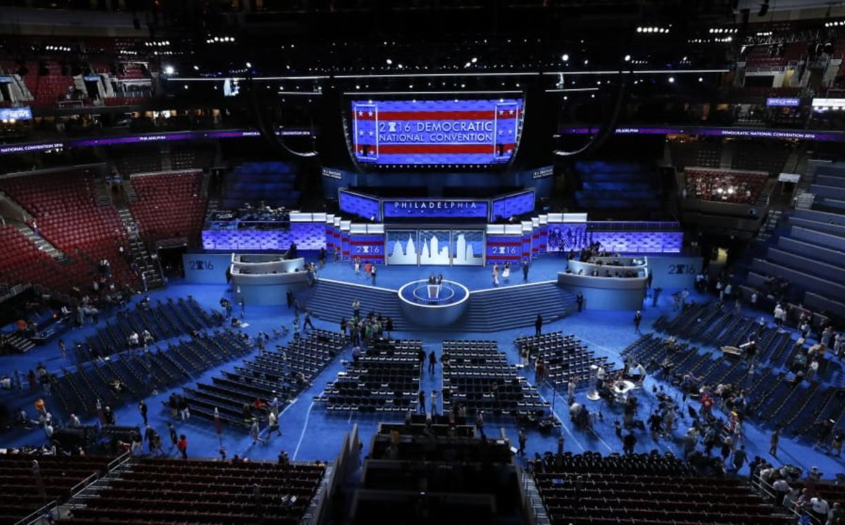 FILE - In this July 24, 2016, file photo, workers prepare for the Democratic National Convention in Philadelphia. Democratic presidential candidate former Vice Presiden JoBiden's presidential nominating convention will highlight the U.S. political spectrum from the left flank of New York Rep. Alexandria Ocasio-Cortez to the Republican old guard of former Ohio Gov. John Kasich.