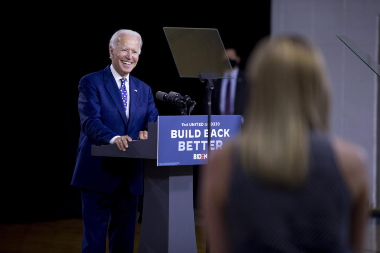 "Democratic presidential candidate former Vice President Joe Biden smiles as he takes a question from a reporter at a campaign event at the William ""Hicks"" Anderson Community Center in Wilmington, Del., Tuesday, July 28, 2020.(AP Photo/Andrew Harnik)"