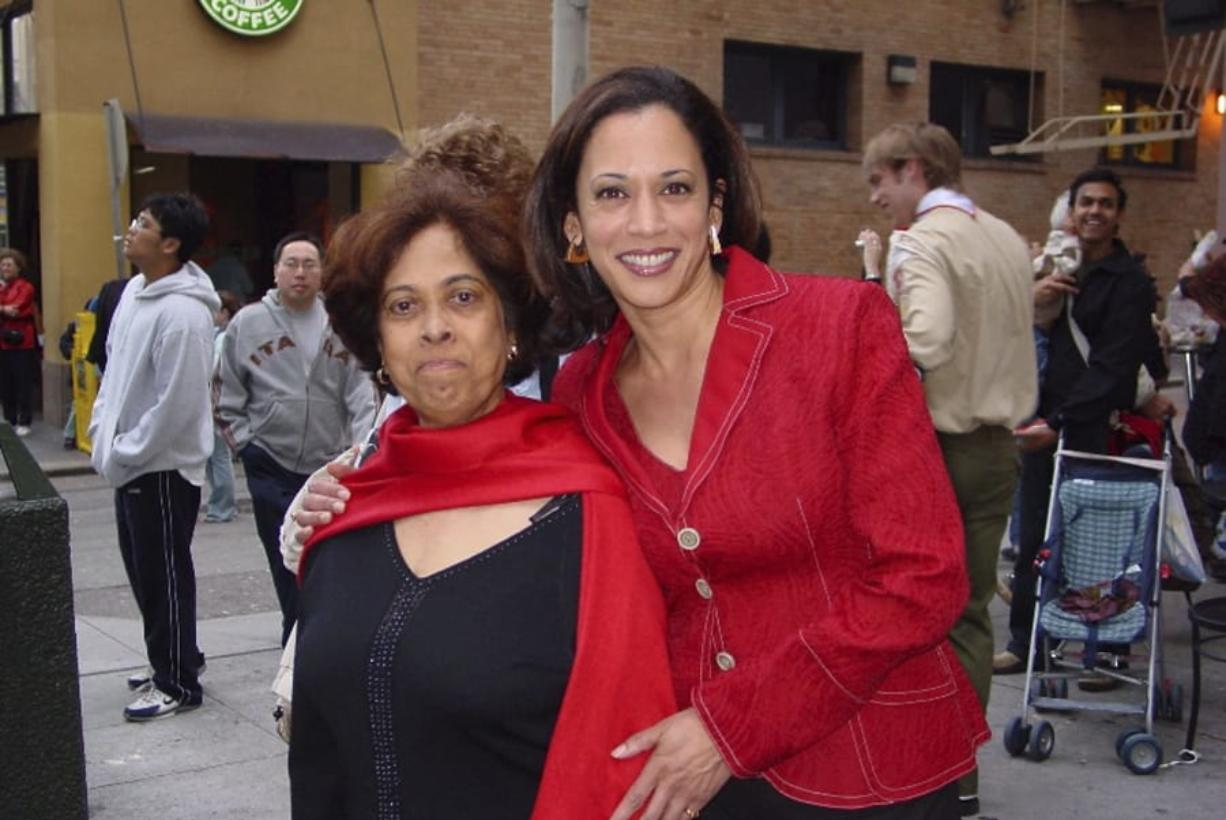 This 2007 photo provided by the Kamala Harris campaign shows her with her mother, Shyamala, at a Chinese New Year parade.