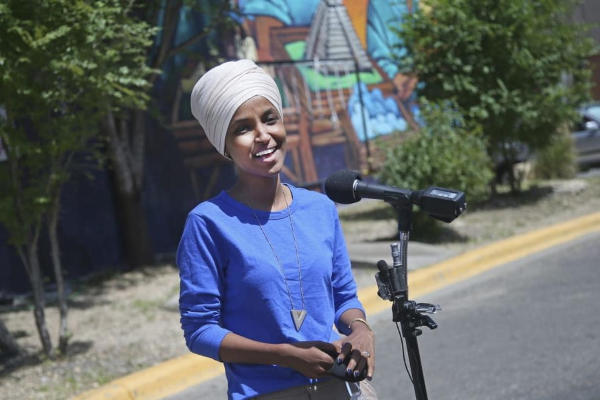 Democrat Rep. Ilhan Omar addresses media after lunch at the Mercado Central in Minneapolis Tuesday, Aug. 11, 2020, primary Election Day in Minnesota.