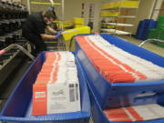 Ballots sit in sorting trays Aug. 5 at the King County Elections headquarters in Renton. (ted s.
