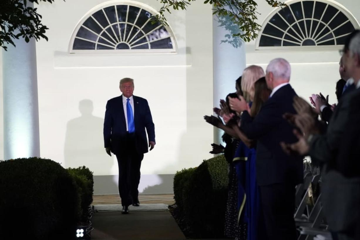 President Donald Trump arrives to listen to first lady Melania Trump speak during the 2020 Republican National Convention from the Rose Garden of the White House, Tuesday, Aug. 25, 2020, in Washington.