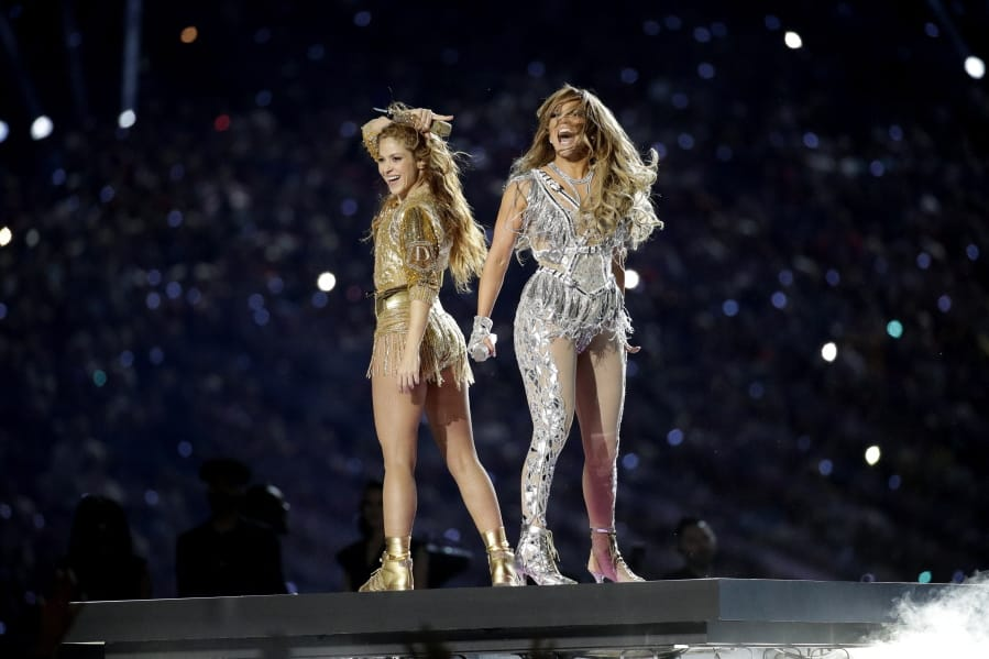FILE - Shakira, left, and Jennifer Lopez perform during halftime of the NFL Super Bowl 54 football game between the Kansas City Chiefs and the San Francisco 49ers in Miami Gardens, Fla. on  Feb. 2, 2020. Lopez and Shakira's show-stopping Super Bowl halftime performance is nominated for four Emmy Awards.