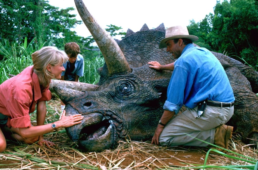 "This image released by Universal Pictures shows, from left, Laura Dern, Joseph Mazzello and Sam Neill in a scene from the 1993 film ""Jurassic Park."" With all major new releases postponed until at least Labor Day weekend due to the pandemic, summer moviegoing has belonged to the classics. ""Jurassic Park"" has led them all with a bit more than $3 million in ticket sales this summer, according to several people who have seen box-office grosses."