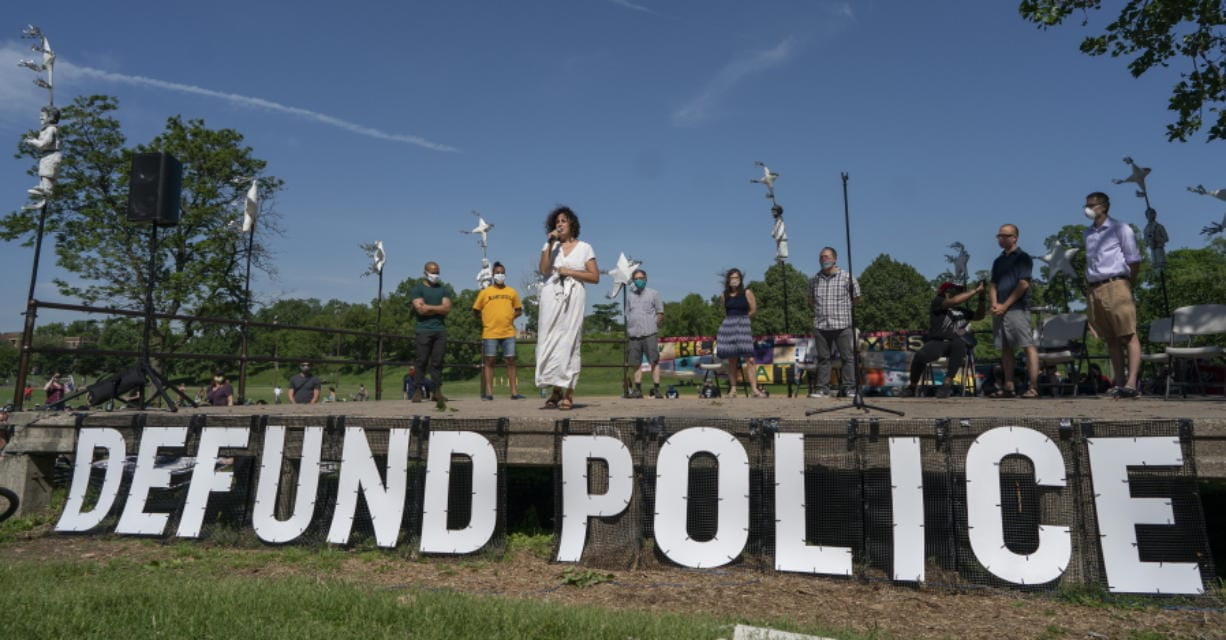"""FILE - In this June 7, 2020, file photo, Alondra Cano, a City Council member, speaks during """"The Path Forward"""" meeting at Powderhorn Park in Minneapolis. The focus of the meeting was the defunding of the Minneapolis Police Department. A Minneapolis commission decided Wednesday, Aug. 5, to take more time to review a City Council amendment to dismantle the Police Department in the wake of George Floyd's death, ending the possibility of voters deciding the issue in November."""