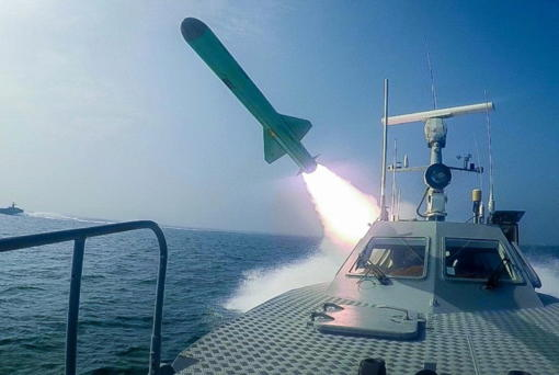 In this photo released July 28, a Revolutionary Guard speed boat fires a missile during a military exercise. The drill appeared aimed at threatening the U.S. amid tensions between Tehran and Washington.