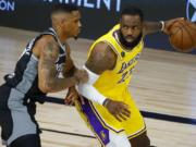 Sacramento Kings' DaQuan Jeffries, left, defends against Los Angeles Lakers' LeBron James during the second quarter of an NBA basketball game Thursday, Aug. 13, 2020, in Lake Buena Vista, Fla. (Kevin C. Cox/Pool Photo via AP) (Kevin C.