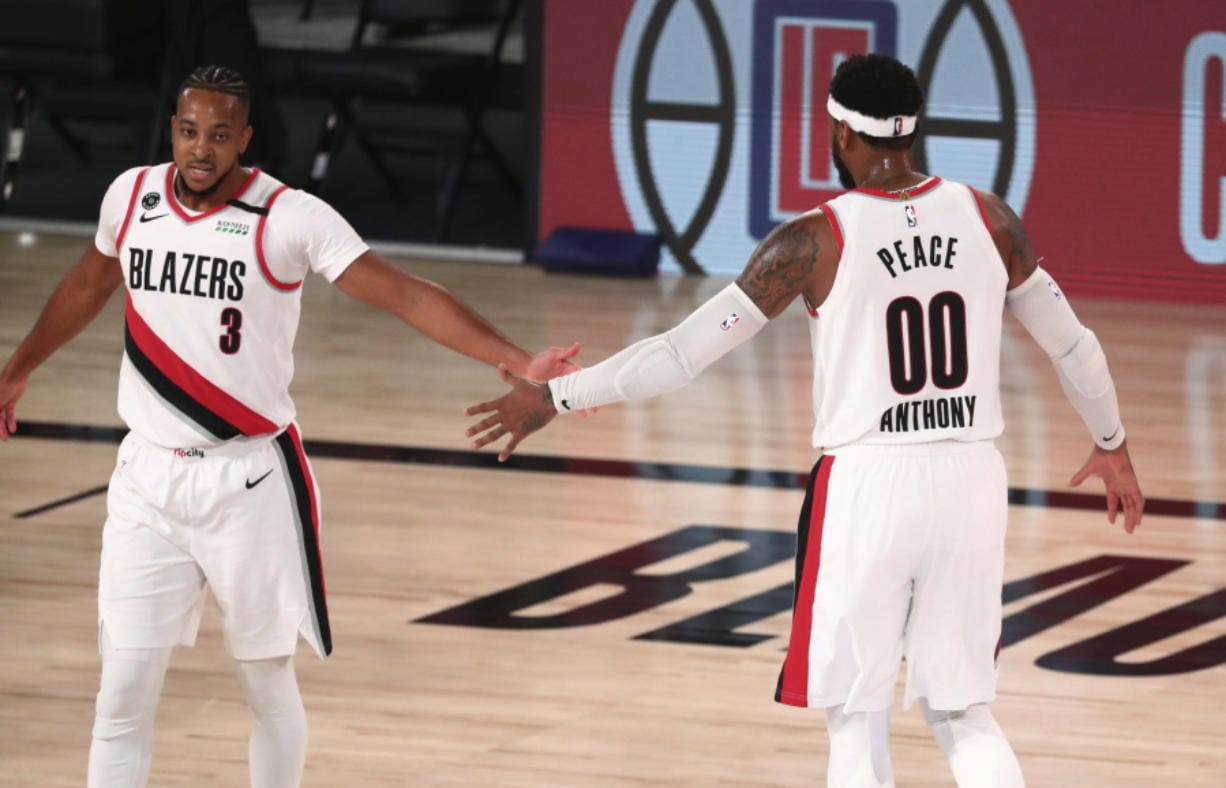 Portland guard CJ McCollum (3) and forward Carmelo Anthony (00) each played key roles in helping the Trail Blazers reach the NBA playoffs for the seventh consecutive season.  The Blazers were a longshot to reach the playoffs, but won seven of nine seeding and play-in games.