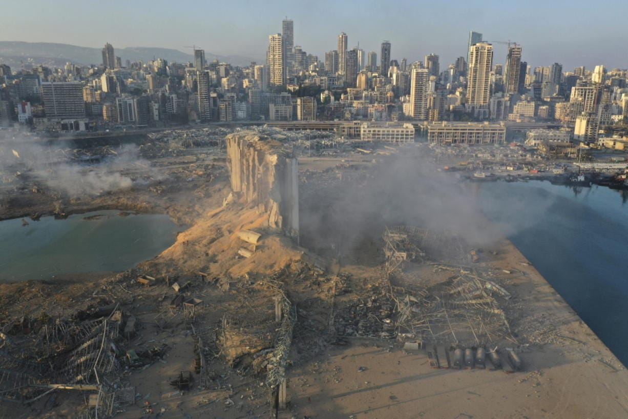 A drone picture shows the scene of an explosion at the seaport of Beirut, Lebanon, Wednesday, Aug. 5, 2020. A massive explosion rocked Beirut on Tuesday, flattening much of the city's port, damaging buildings across the capital and sending a giant mushroom cloud into the sky. More than 70 people were killed and 3,000 injured, with bodies buried in the rubble, officials said.