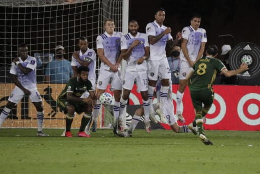 Orlando players block a free kick by Portland Timbers midfielder Diego Valeri (8), during the second half of an MLS soccer match, Tuesday, Aug. 11, 2020, in Kissimmee, Fla.