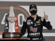 William Byron stands with his trophy in Victory Lane after winning the NASCAR Cup Series auto race at Daytona International Speedway, Saturday, Aug. 29, 2020, in Daytona Beach, Fla.