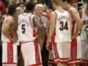 Arizona head coach Lute Olson, center, talks to his players, during a game in 2006. The Hall of Fame coach who turned Arizona into a college basketball powerhouse, died Thursday, Aug. 27, 2020, at the age of 85. Cause of death was not reported.