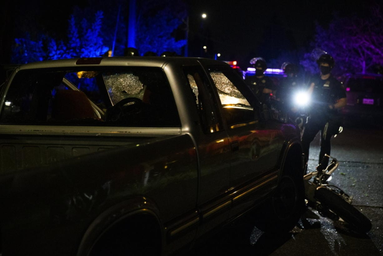 A pickup truck was abandoned several blocks west after its driver accelerated towards the crowd, hitting and dragging a motorcycle during a protest in Portland, Ore., on Tuesday, Aug. 4, 2020.