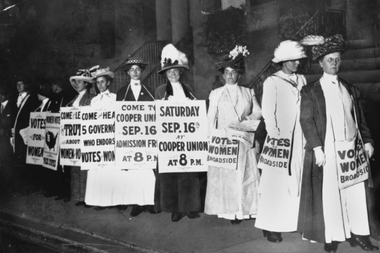 FILE - In this September 1916 file photo, demonstrators hold a rally for women's suffrage in New York. The Seneca Falls convention in 1848 is widely viewed as the launch of the women's suffrage movement, yet women didn't gain the right to vote until ratification of the 19th Amendment in 1920.