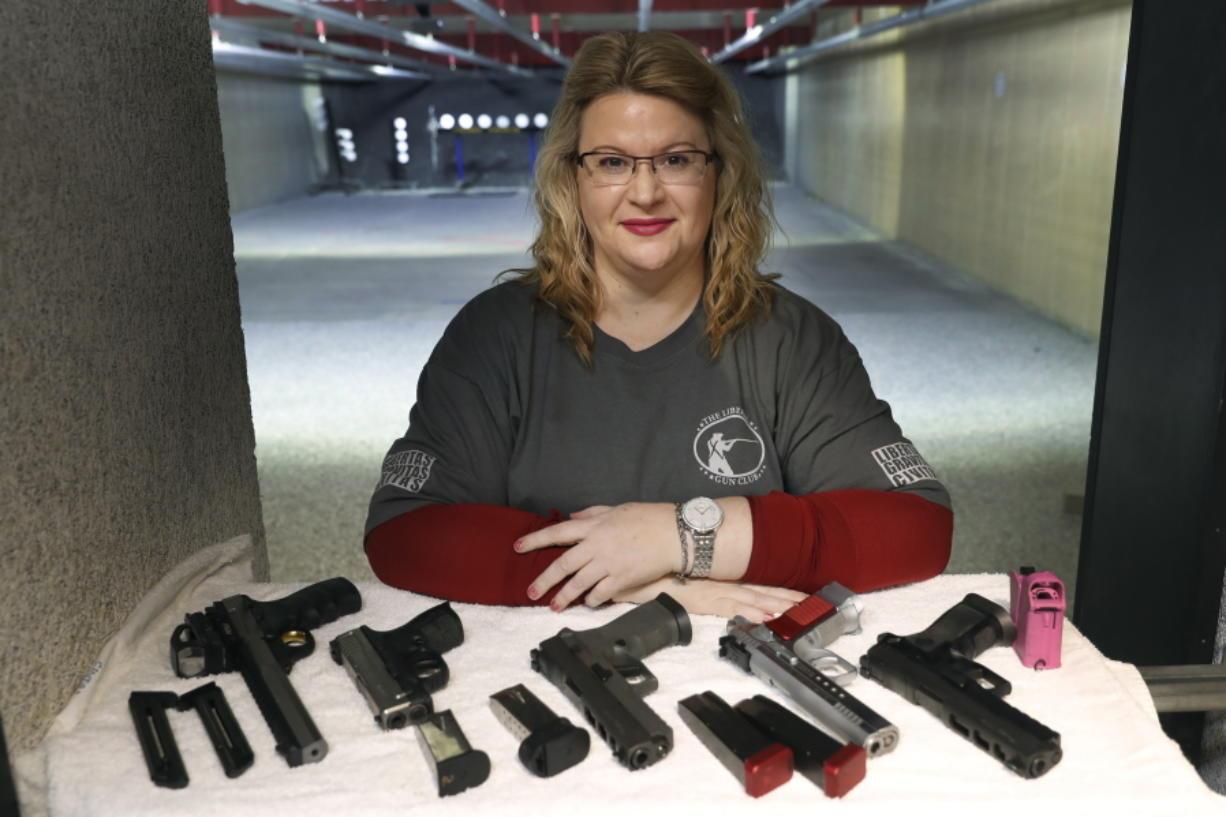 Kat Ellsworth displays five of the seven guns she owns Feb. 5 at the Caliber Tactical Gun Range in Waukegan, Ill.